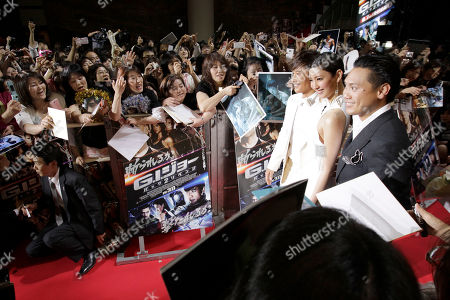 """Lee Byung-hun, Jon M. Chu, Nanao South Korean actor Lee Byung-hun, third from right, and director Jon M. Chu, right, pose with Japanese actress Nanao for photographers during the Japan premiere of his latest film """"GI Joe 3D Retaliation"""" in Tokyo"""