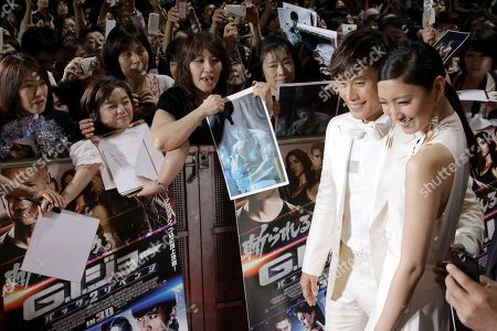 """Lee Byung-hun, Nanao South Korean actor Lee Byung-hun poses for photographers with Japanese actress Nanao upon arrival for the Japan premiere of his latest film """"GI Joe 3D Retaliation"""" in Tokyo"""
