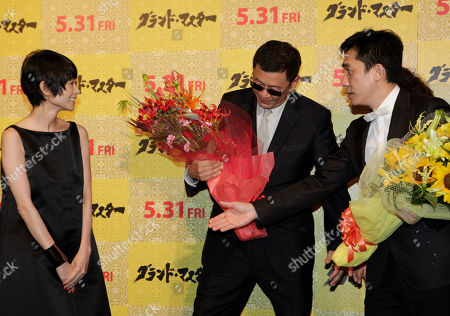 "Tony Leung, Wong Kar-wai, Yoko Maki Hong Kong actor Tony Leung, right, and director Wong Kar-wai, center, greet Japanese actress Yoko Maki during the Japan premiere of their latest film ""The Grandmaster"" in Tokyo"