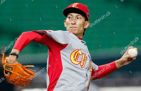 Stock Image of Xin Li China's starter Xin Li delivers a pitch against Cuba in the first inning of their World Baseball Classic first round game in Fukuoka, Japan