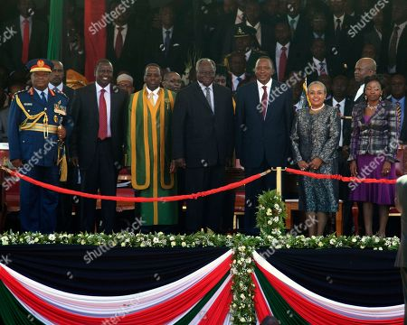From left to right, Kenyan Julius Karangi, Chief of Defence forces, Kenyan Deputy president, William Ruto, Kenyan Supreme court judge Willy Mutungq, Outgoing Kenyan President Mwai Kibaki, Kenyan president Uhuru Kenyatta, Margaret Uhuru Kenyatta and Rachiel Ruto, pose for a group photo after the Inauguration ceremony at Moi International Sports Complex in Nairobi, Kenya . Uhuru Kenyatta was sworn in as the Kenya's fourth president Tuesday in a stadium filled with tens of thousands of Kenyans and a dozen African leaders