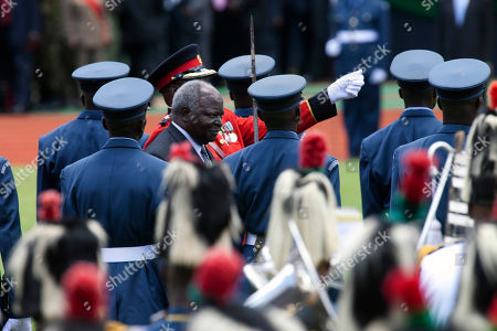 Kenyan outgoing president Mwai Kibaki inspects guard of honor during Inauguration ceremony of President Uhuru at Moi International Sports Complex in Nairobi, Kenya, . Uhuru Kenyatta was sworn in as the Kenya's fourth president Tuesday in a stadium filled with tens of thousands of Kenyans and a dozen African leaders. Kenyatta, 51, the son of Kenya's first president, becomes the second sitting African president to face charges at the International Criminal Court over allegations he helped orchestrate the vicious tribe-on-tribe violence that marred Kenya's 2007 presidential election