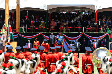 Kenyan outgoing president, Mwai Kibaki, middle in suit, takes the salute during President elect Uhuru Kenyatta's Inauguration ceremony at Moi International Sports Complex in Nairobi, Kenya, . Uhuru Kenyatta was sworn in as the Kenya's fourth president Tuesday in a stadium filled with tens of thousands of Kenyans and a dozen African leaders. Kenyatta, 51, the son of Kenya's first president, becomes the second sitting African president to face charges at the International Criminal Court over allegations he helped orchestrate the vicious tribe-on-tribe violence that marred Kenya's 2007 presidential election