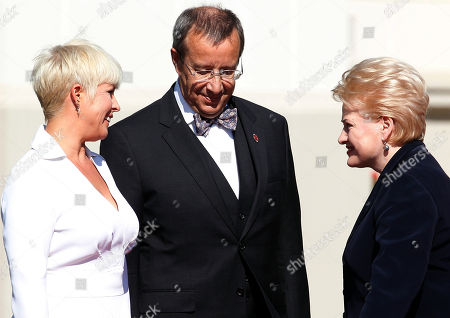 Toomas Hendrik Ilves, Dalia Grybauskaite, Evelin Ilves Estonia's President Toomas Hendrik Ilves, center, and his wife Evelin Ilves, left, speaks to the Lithuania's President Dalia Grybauskaite prior to their meeting at the President palace in Vilnius, Lithuania