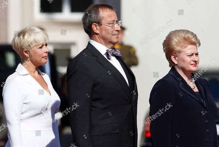 Toomas Hendrik Ilves, Dalia Grybauskaite, Evelin Ilves Lithuania's President Dalia Grybauskaite, right, Estonia's President Toomas Hendrik Ilves, center, and his wife Evelin Ilves, left, listen to the Estonian national anthem outside the Presidential palace during a welcome ceremony in Vilnius, Lithuania