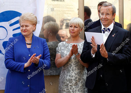 Toomas Hendrik Ilves, Dalia Grybauskaite, Evelin Ilves Estonia's President Toomas Hendrik Ilves, right, his wife Evelin Ilves, center, and Lithuania's President Dalia Grybauskaite, left, attends the opening of the Estonian memorial board in the old city in Vilnius, Lithuania