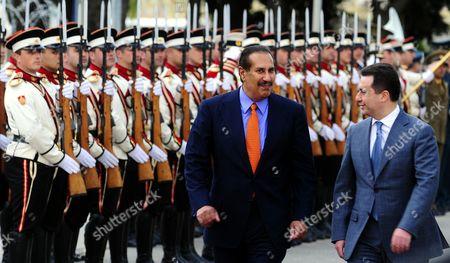 Stock Image of Hamad bin Jassim bin Jaber Al Thani, Nikola Gruevski Qatari Prime Minister Sheikh Hamad bin Jassim bin Jaber Al Thani, is welcomed by Macedonian Prime Minister Nikola Gruevski, right, upon his arrival to Skopje, Macedonia, on