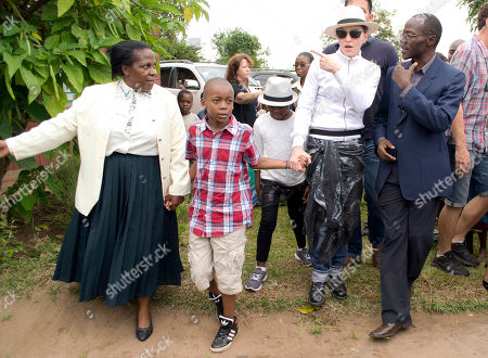 Madonna US performer Madonna tours the Mphandura orpahange near Lilongwe, Malawi . Madonna, is spending her fourth day in the southern African country from where she adopted two children David Banda, second from left and Mercy James, third from left