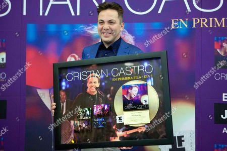 "Cristian Castro Mexican singer Cristian Castro shows a gold record of his latest album during a photo call in Mexico City, . Castro presented his album ""Cristian Castro - Primera Fila Vol. 1"" or ""Cristian Castro - Front Row Vol. 1"