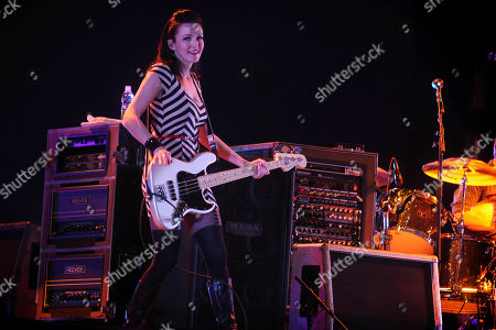 Nicole Fiorentino Nicole Fiorentino, bass guitarist for The Smashing Pumpkins performs with the band during the Cumbre Tajin 2013 music festival in Papantla, Mexico