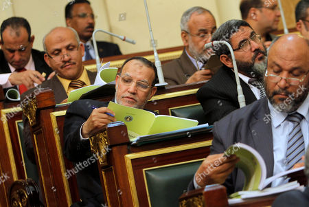 Essam el-Erian Egyptian Shura council member and vice president of the Muslim Brotherhood's Freedom and Justice Party Essam el-Erian, center, reads the government's 2013-2014 budget at the Shura Council, Parliament's upper house