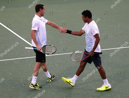 Mahesh Bhupathi, Michael Llodra Mahesh Bhupathi of India, right, and Michael Llodra of France celebrate a point during the doubles final against Robert Lindstedt of Sweden and Nenad Zimonjic of Serbia in the Dubai Duty Free Tennis Championships in Dubai, United Arab Emirates