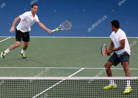Michael Llodra, Mahesh Bhupathi Michael Llodra of France returns as team mate Mahesh Bhupathi of India looks on during the doubles final against Robert Lindstedt of Sweden and Nenad Zimonjic of Serbia in the Dubai Duty Free Tennis Championships in Dubai, United Arab Emirates