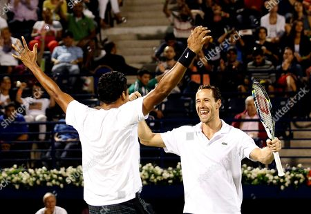 Mahesh Bhupathi, Michael Llodra Michael Llodra of France, left, and teammate Mahesh Bhupathi of India celebrate their doubles win against Robert Lindstedt of Sweden and Nenad Zimonjic of Serbia in the Dubai Duty Free Tennis Championships in Dubai, United Arab Emirates