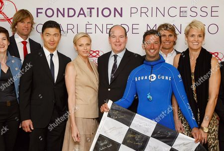 Prince Albert II, Pincess Charlene, Bjorn Maaseide, Rick Yune, Pierre Frolla, Jamie Mitchell, Dara Torres Prince Albert II of Monaco, center, and his wife Princess Charlene, third left, surrounded by Norvegian volley-ball player Bjorn Maaseide, left, US actor Rick Yune, second left, free diver Pierre Frolla of Monaco, third right, ocean paddler Jamie Mitchell, second right, US swimmer Dara Torres, during the presentation of ambassadors for Princess Charlene Foundation at the Yacht Club, in Monaco