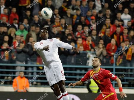 England's Danny Wellbeck, left is challenged by Montenegro's Milan Jovanovic during their World Cup group H qualifying soccer match at City Stadium in Podgorica, Montenegro