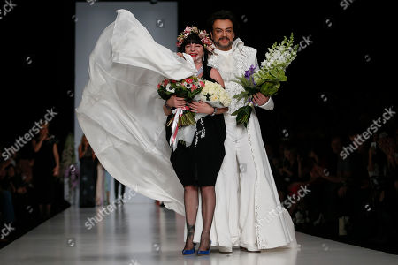 Elena Souproun, Philipp Kirkorov Russian designer Elena Souproun, left, singer Philipp Kirkorov displays a creation during Moscow Fashion Week in Russia, on