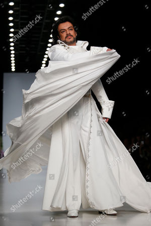 Philipp Kirkorov Russian singer Philipp Kirkorov displays a creation by Russian designer Elena Souproun during Moscow Fashion Week in Russia, on