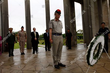 Britain's Chief of Defense Staff Gen. Sir David Richards salutes as he lays a wreath of flowers at the Allied War Memorial Cemetery in Htauk Kyant, in Yangon, Myanmar. Britain's most senior serving military officer concluded a visit to Myanmar, the first visit by the head of a Western nation's armed forces since the reform process began