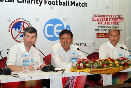Denis Irwin, left, former Manchester United player, talks to journalists during a press conference of All Star Charity Football Match along with Zaw Zaw, centre, President of Myanmar Football Federation (MFF), and Clayton Blackmore, right, at Park Royal hotel, in Yangon, Myanmar