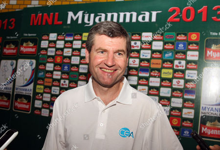 Denis Irwin, former Manchester United player, talks to journalists as he and Clayton Blackmore visit Thuwunna stadium, in Yangon, Myanmar
