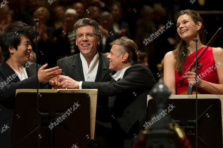 Lang Lang, Mariss Jansons, Janine Jansen, Thomas Hampson China's Lang Lang, U.S. baritone Thomas Hampson, Latvian director Mariss Jansons and Netherlands violist Janine Jansen, from left to right, acknowledge the audience's applause after a concert marking the 125th anniversary of the Royal Concert Hall Orchestra in Amsterdam, Netherlands