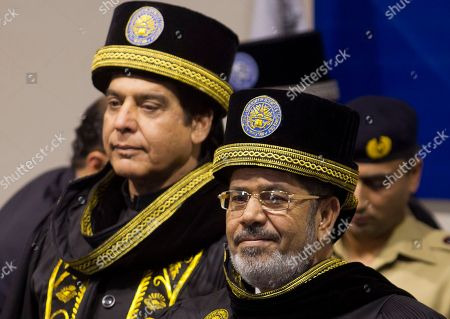 Mohamad Morsi Pakistan's Prime Minister Raja Pervaiz Ashraf, left, and Egyptian President Mohammed Morsi, right, attend an honorary ceremony from Pakistan's National University of Sciences and Technology, in Islamabad, Pakistan on . Morsi arrived to Pakistan on a day trip to discuss bilateral issues with Pakistani leadership