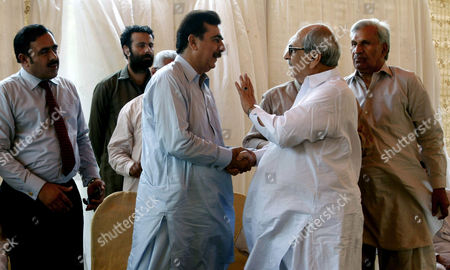 Pakistan's former Prime Minister Yousuf Raza Gilani, center, receives people arriving at his residence to console over his son's abduction in Multan, Pakistan, . Gunmen attacked an election rally in Pakistan's southern Punjab province on Thursday and abducted Ali Haider Gilani, son of a former prime minister, intensifying what has already been a violent run-up to Saturday's nationwide elections