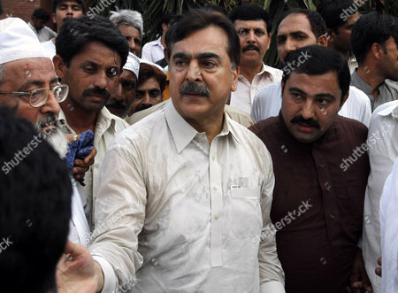 Yousuf Raza Gilani People visit Pakistan's former Prime Minister Yousuf Raza Gilani, center, at his residence in Multan, Pakistan, . Gunmen attacked an election rally in Pakistan's southern Punjab province on Thursday and abducted Ali Haider Gilani, son of a former prime minister, intensifying what has already been a violent run-up to Saturday's nationwide elections