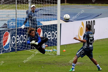 Honduras goalkeeper Kevin Hernandez, left, blocks a shot during a training session in Panama City, . Honduras will face Panama in a 2014 World Cup qualifying soccer match on Tuesday