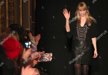 Dutch fashion designer Steffie Christiaens waves after the presentation of her Fall-Winter 2013-2014 Ready to Wear fashion collection, Tuesday, Feb.26, 2013 in Paris
