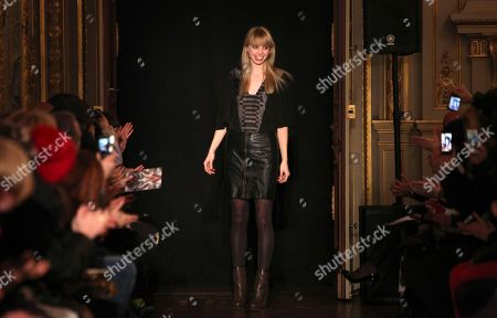 Dutch fashion designer Steffie Christiaens reacts after the presentation of her Fall-Winter 2013-2014 Ready to Wear fashion collection, in Paris
