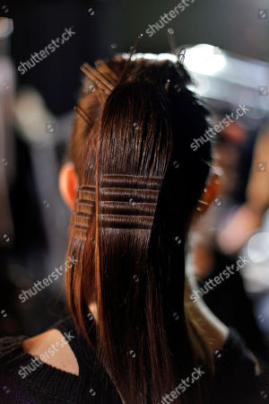 A model's hair is styled backstage prior to Dutch fashion designer Steffie Christiaens' ready to wear Fall/Winter 2013-2014 collection, in Paris