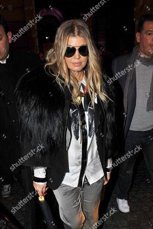 American singer Stacy Ann Ferguson, Fergie, leaves British fashion designer Gareth Pugh's Ready to Wear's Fall-Winter 2013-2014 fashion collection, presented, Wednesday, Feb.27, 2013 in Paris