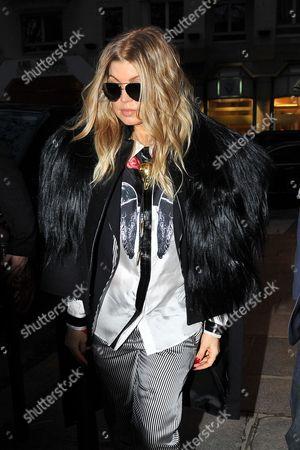 US singer Stacy Ann Ferguson, Fergie, leaves British fashion designer Gareth Pugh's Ready to Wear's Fall-Winter 2013-2014 fashion collection, presented, in Paris