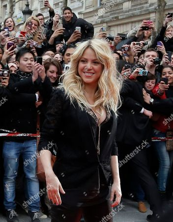 """Shakira Colombian singer Shakira arrives for a promotion event on the Champs Elysee in Paris. The singer and judge on """"The Voice"""" is asking a New York judge to throw out a $250 million lawsuit filed by her ex, Antonio de La Rua. De la Rua is the son of former Argentine President Fernando de la Rua. He dated Shakira for more than a decade before they split in 2011"""