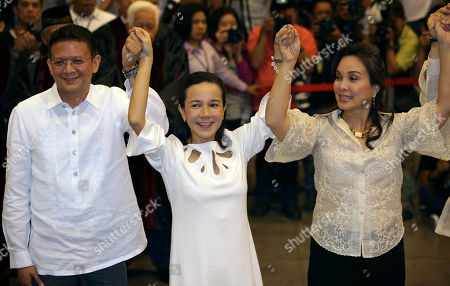 Sen. Francis Joseph Escudero, Sen. Grace Poe, Sen. Loren Legarda Newy proclaimed Philippine senators, from left, Sen. Francis Joseph Escudero, Sen. Grace Poe and Sen. Loren Legarda raise hands at the National Board Canvassing Center in suburban Pasay, south of Manila, Philippines on . Half of the 12 winning senatorial bets were formally proclaimed today after more than 50 million Filipinos trooped to polling centers to elect senators, congressmen and municipal mayors for the country's midterm elections last Monday
