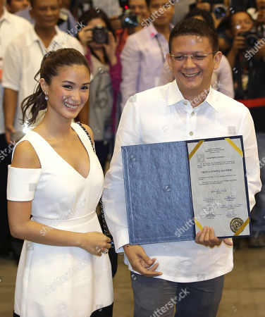 Sen. Francis Joseph Escudero, Heart Evangelista Newly proclaimed Philippine Sen. Francis Joseph Escudero, right, shows his certificate of proclamation, beside his girlfriend, Filipina actress Heart Evangelista, at the National Board Canvassing Center in suburban Pasay, south of Manila, Philippines on . Half of the 12 winning senatorial bets were formally proclaimed Thursday after more than 50 million Filipinos trooped to polling centers to elect senators, congressmen and municipal mayors for the country's midterm elections on Monday