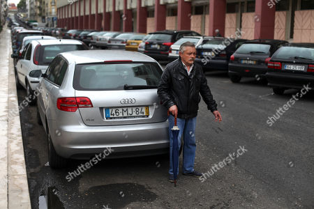 Celestino Ribeiro, 56, who has been unemployed for three years, works for small change helping people to park their car outside the Bank of Portugal offices in Lisbon, . Ribeiro, who worked as a painter in the construction sector for 41 years, receives euros 176 (USD 229) a month in benefits. Inspectors from Portugal's bailout lenders are back in Lisbon to see how the government intends to plug a euro 1.3 billion (USD 1.7 billion) hole in its state budget