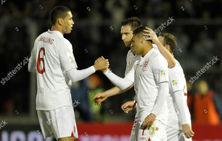 England's Alex Oxlade-Chamberlain, center, celebrates with his teammates Chris Smalling, left, and Frank Lampard, after scoring, during a World Cup qualifying group H soccer match between England and San Marino at the Serravalle stadium, Italy
