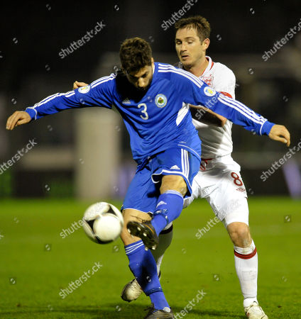 San Marino's Mirko Palazzi, left, competes for the ball with England's Frank Lampard, during a World Cup qualifying group H soccer match at the Serravalle stadium, Italy