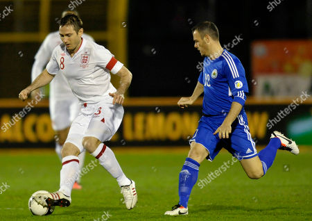 San Marino's Andy Selva, right, watches as England's Frank Lampard controls the ball, during a World Cup qualifying group H soccer match at the Serravalle stadium, Italy