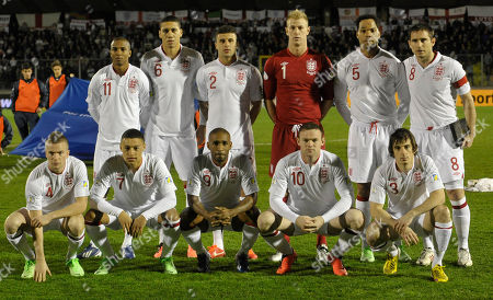 England soccer team poses prior to the start of a World Cup qualifying group H soccer match between England and San Marino at the Serravalle stadium, Italy, . Back row, standing, from left, Ashley Young, Chris Smalling, Kyle Walker, Joe Hart, Joleon Lescott and Frank Lampard. Front row, from left, Tom Cleverley, Alex Oxlade-Chamberlain, Jermain Defoe, Wayne Rooney and Leighton Baines