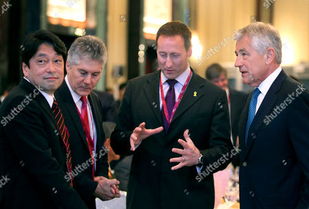 Itsunori Onodera, Stephen Smith, Peter Gordon MacKay, Chuck Hagel U.S. Defense Secretary Chuck Hagel, right, speaks with Canada's National Defense Minister Peter Gordon MacKay, second right, as Japan's Defense Minister Itsunori Onodera, left, and Australian Defense Minister Stephen Smith, second left, listen at the opening session of the International Institute for Strategic Studies Shangri-la Dialogue, or IISS Asia Security Summit on in Singapore. The meetings will be held from May 31 to June 2