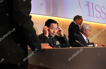 Qi Jianguo, Voltaire Gazmin, John Chipman, Peter Gordon MacKay China's Lt. Gen. Qi Jianguo, Deputy Chief of General Staff, People's Liberation Army, adjusts his headphones while Philippines Defense Secretary Voltaire Gazmin, right, is seated beside him and standing at the back is Chairman of IISS John Chipman, back left, and Canada's National Defense Minister Peter Gordon MacKay, back right, at the International Institute for Strategic Studies Shangri-la Dialogue, or IISS Asia Security Summit in Singapore, in Singapore