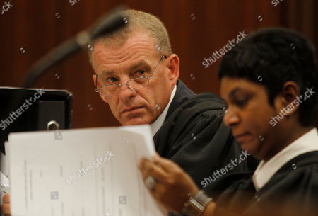 Gerrie Nel Taken state prosecutor Gerrie Nel, prepares for a hearing in the Pretoria, South Africa high court opposing the bail conditions of athlete Oscar Pistorius who is charged with the shooting death of his girlfriend Reeva Steenkamp. At the start of Pistorius' trial Monday March 3, 2014, prosecutors pressing the murder charge have listed 107 witnesses they're able to call and some will say that the world-famous athlete had a fight with Steenkamp and then intentionally killed her