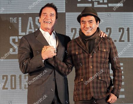 "Arnold Schwarzenegger, Kim Jee-woon Actor Arnold Schwarzenegger, left, poses with South Korean director Kim Jee-woon before a press conference to promote their latest film ""The Last Stand"" in Seoul, South Korea, . The movie will open on Thursday, Feb. 21, in South Korea"