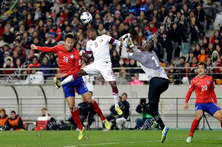 Lee Geun-ho, Qasem Burhn, Musab Mahmoud, Lee Dong-gook South Korea's Kim Shin-wook, left, fights for the ball against Qatar's goalkeeper Qasem Burhn (1) and Musab Mahmoud (5) as South Korea's Lee Dong-gook, right, looks on during their Group A Asian qualifying soccer match for the World Cup tournament in Seoul, South Korea, . South Korean won the match 2-1