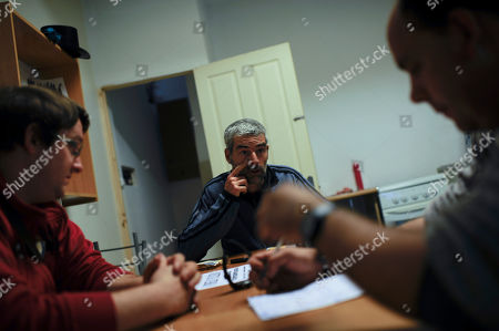 Eneko Yoldi, Alberto Iglesias, Israel Gonzalez Eneko Yoldi, 29, left, meets with Alberto Iglesias, 45, center, and Israel Gonzales, 32, at an association for the unemployed, in Pamplona, northern Spain, . Spain's Labor Ministry said the number of people registered as unemployed fell by 46,050 in April with more people finding jobs in the run-up to the summer tourist season. Spain has been in recession for the best part of the past four years as the economy battles to recover from the collapse of its once-booming real estate sector. The total number registered as jobless stands at 4.99 million