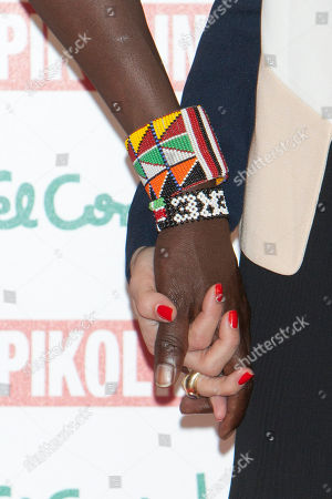 Stock Image of Olivia Palermo and William Kikanae Masai leader William Kikanae and actress and model Olivia Palermo pose to present the new 'Pikolinos' Maasai collection at the Corte Ingles Castellana store in Madrid, Spain